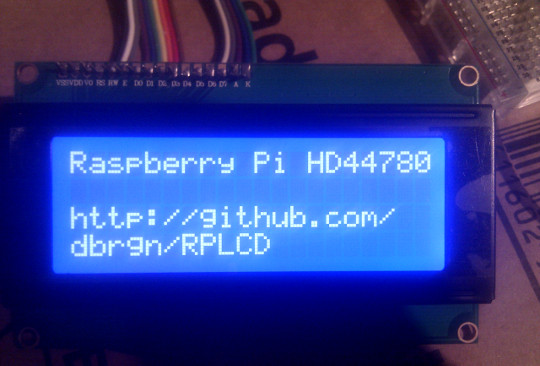 A photo of the HD44780 LCD module displaying some text.